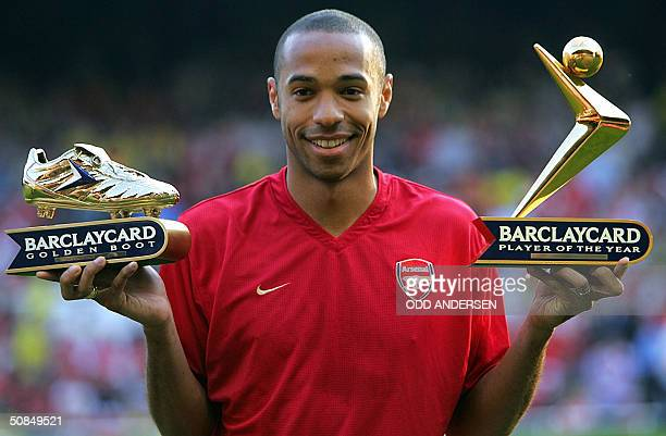 Arsenal's Thierry Henry with the Golden Boot and Player of the Year award presented before a testimonial football match for teammate Martin Keown at...