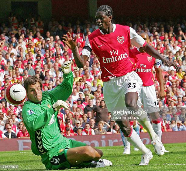 Arsenal's togolese player Emmanuel Adebayor tries to shoot past the Aston Villa goalkeeper Thomas Sorensen during their first Premiership football...