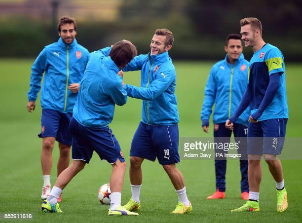 Arsenal's Tomas Rosicky and Jack Wilshere during a training session at London Colney Hertfordshire
