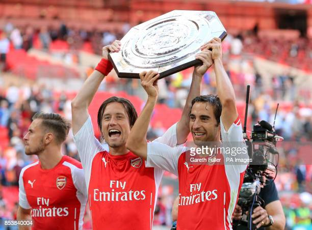 Arsenal's Tomas Rosicky and Mathieu Flamini celebrate victory over the Manchester City in the Community Shield match at Wembley Stadium London