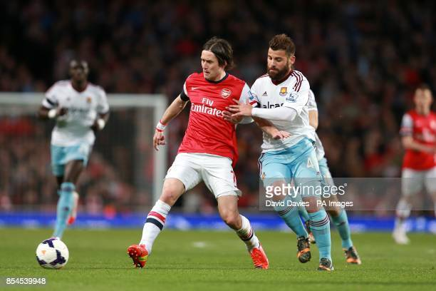 Arsenal's Tomas Rosicky and West Ham United's Antonio Nocerino battle for the ball