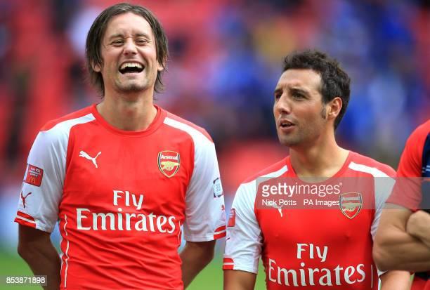 Arsenal's Tomas Rosicky enjoys a joke from Santi Cazorla