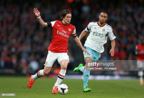 Arsenal's Tomas Rosicky gets away from West Ham United's Winston Reid as they battle for the ball