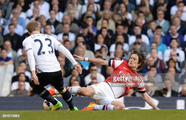 Arsenal's Tomas Rosicky wins the ball