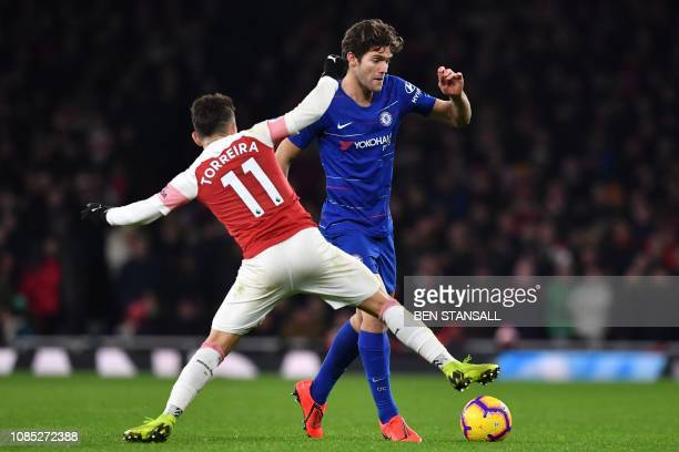 Arsenal's Uruguayan midfielder Lucas Torreira vies with Chelsea's Spanish defender Marcos Alonso during the English Premier League football match...