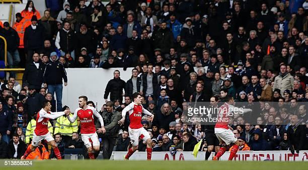 Arsenal's Welsh midfielder Aaron Ramsey Arsenal's Chilean striker Alexis Sanchez Arsenal's Spanish defender Hector Bellerin and Arsenal's French...