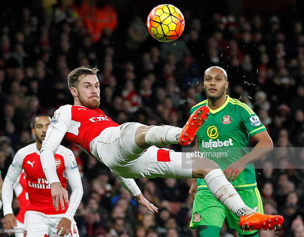 Arsenal's Welsh midfielder Aaron Ramsey attempts a shot on goal during the English Premier League football match between Arsenal and Sunderland at the Emirates Stadium in London on December 5, 2015. USE. No use with unauthorised audio, video, data, fixture lists, club/league logos or 'live' services. Online in-match use limited to 45 images, no video emulation. No use in betting, games or single club/league/player publications.
