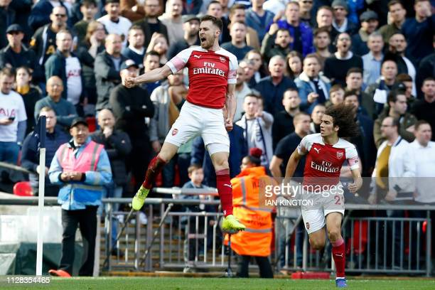 Arsenal's Welsh midfielder Aaron Ramsey celebrates after scoring the opening goal of the English Premier League football match between Tottenham...