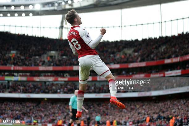 Arsenal's Welsh midfielder Aaron Ramsey celebrates after scoring their second goal during the English Premier League football match between Arsenal...