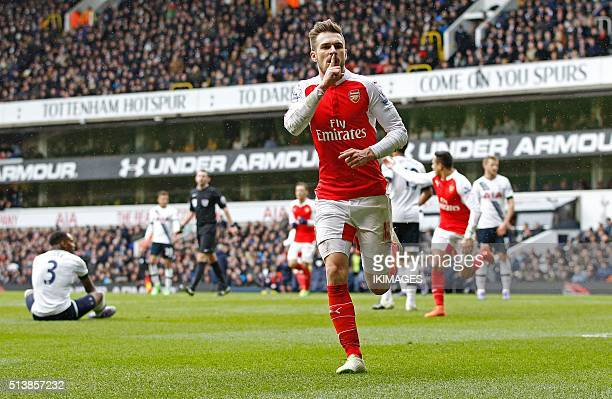 Arsenal's Welsh midfielder Aaron Ramsey celebrates scoring his team's first goal during the English Premier League football match between Tottenham...