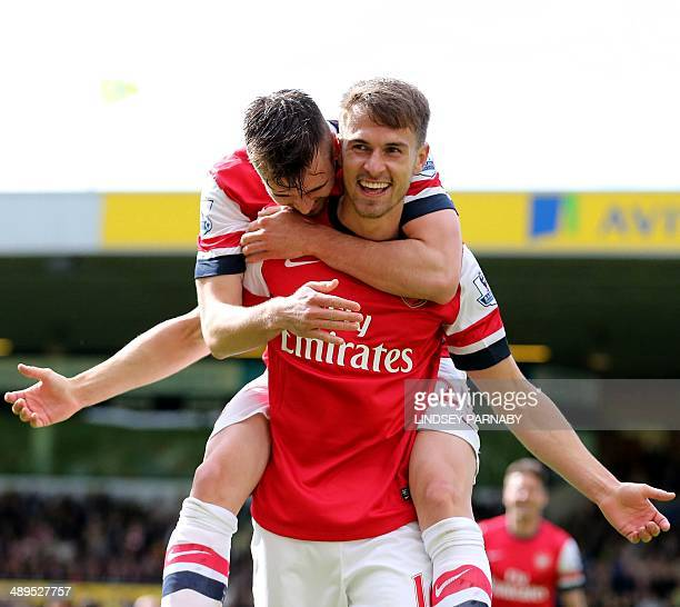 Arsenal's Welsh midfielder Aaron Ramsey celebrates scoring the opening goal during the English Premier League football match between Norwich City and...