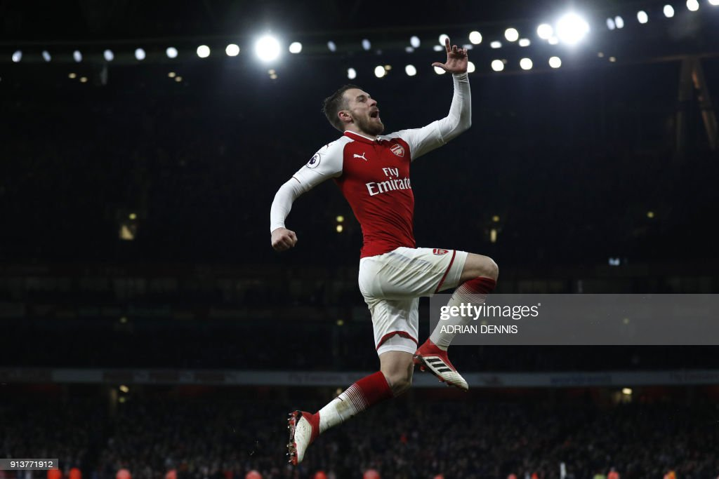 TOPSHOT - Arsenal's Welsh midfielder Aaron Ramsey celebrates scoring the team's fifth goal during the English Premier League football match between Arsenal and Everton at the Emirates Stadium in London on February 3, 2018. (Photo by Adrian DENNIS / AFP) / RESTRICTED TO EDITORIAL USE. No use with unauthorized audio, video, data, fixture lists, club/league logos or 'live' services. Online in-match use limited to 75 images, no video emulation. No use in betting, games or single club/league/player publications. /