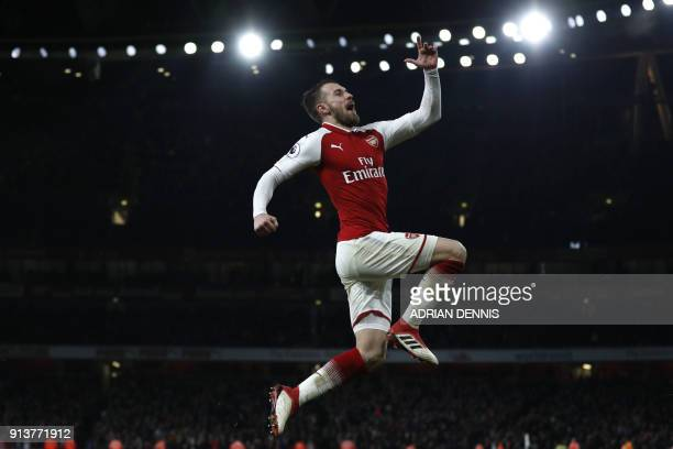 TOPSHOT Arsenal's Welsh midfielder Aaron Ramsey celebrates scoring the team's fifth goal during the English Premier League football match between...