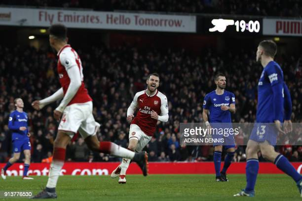 Arsenal's Welsh midfielder Aaron Ramsey celebrates scoring the team's fifth goal during the English Premier League football match between Arsenal and...