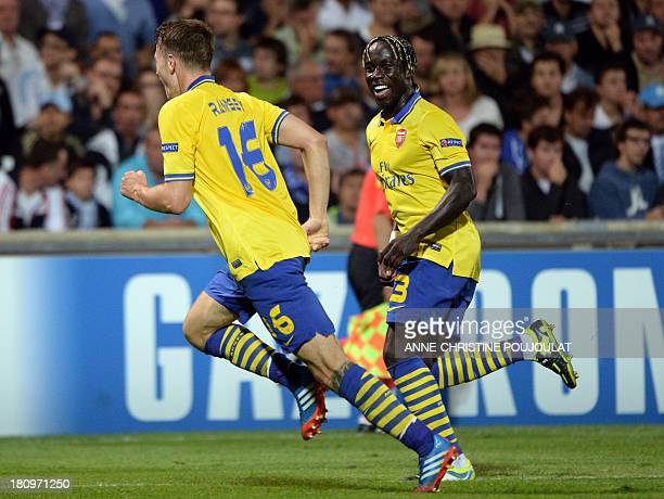 Arsenal's Welsh midfielder Aaron Ramsey celebrates with Arsenal's French defender Bacary Sagna after scoring a goal on September 18 2013 at the...