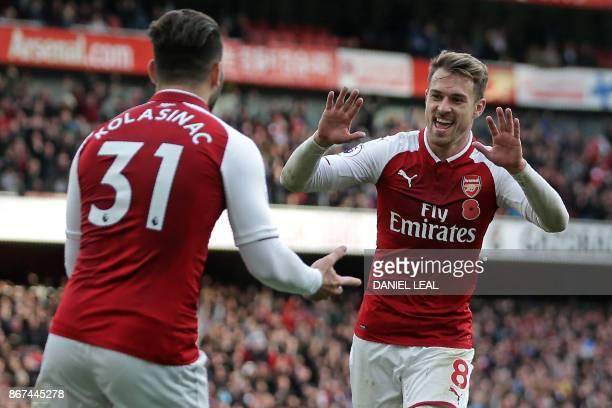 Arsenal's Welsh midfielder Aaron Ramsey celebrates with Arsenal's Germanborn Bosnian defender Sead Kolasinac after scoring their second goal during...