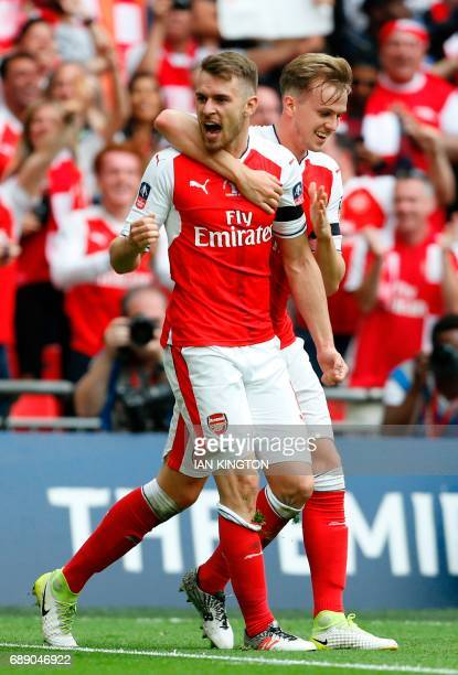 Arsenal's Welsh midfielder Aaron Ramsey celebrates with Arsenal's English defender Rob Holding after scoring their second goal during the English FA...