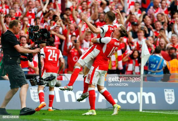 TOPSHOT Arsenal's Welsh midfielder Aaron Ramsey celebrates with Arsenal's English defender Rob Holding after scoring their second goal during the...