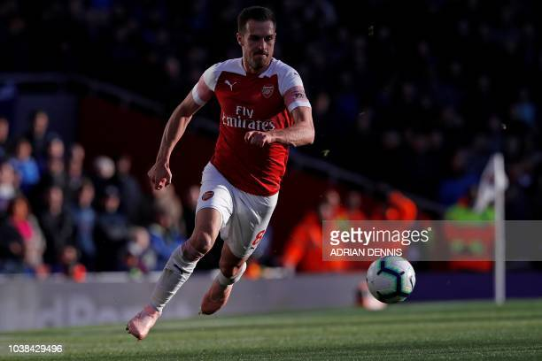 Arsenal's Welsh midfielder Aaron Ramsey controls the ball during the English Premier League football match between Arsenal and Everton at the...