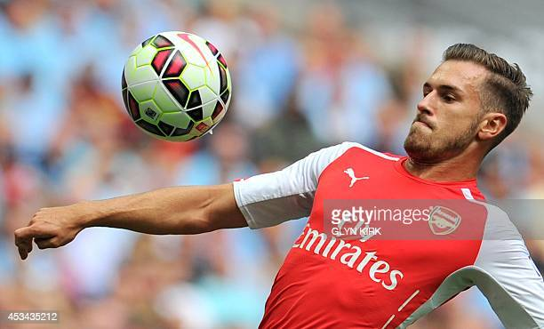 Arsenal's Welsh midfielder Aaron Ramsey eyes the ball during the FA Community Shield football match between Arsenal Manchester City at Wembley...
