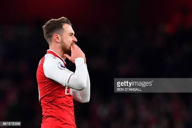 Arsenal's Welsh midfielder Aaron Ramsey reacts after a missing opportunity during the English Premier League football match between Arsenal and...