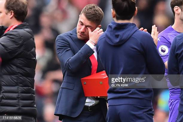 Arsenal's Welsh midfielder Aaron Ramsey reacts at a presentation ceremony on the pitch after the English Premier League football match between...