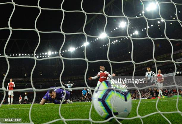 Arsenal's Welsh midfielder Aaron Ramsey scores the opening goal past Newcastle United's Slovakian goalkeeper Martin Dubravka during the English...