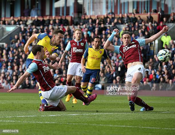 Arsenal's Welsh midfielder Aaron Ramsey scores the opening goal against Burnley during the English Premier League football match between Burnley and...