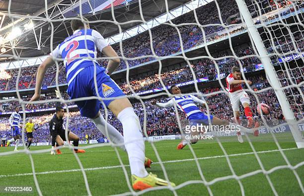 Arsenal's Welsh midfielder Aaron Ramsey shoots and hits the woodwork during the FA Cup semifinal between Arsenal and Reading at Wembley stadium in...