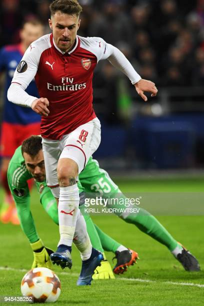 Arsenal's Welsh midfielder Aaron Ramsey vies CSKA Moscow's Russian goalkeeper Igor Akinfeev during the UEFA Europa League second leg quarterfinal...