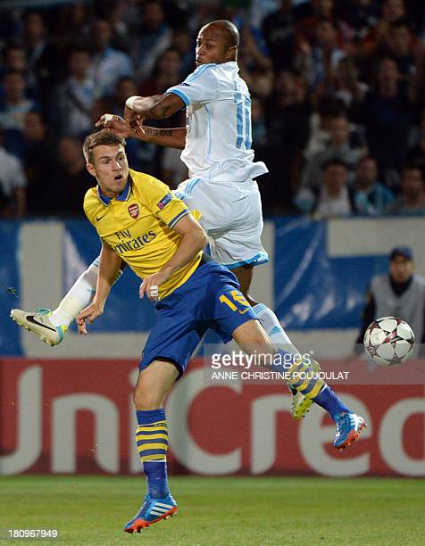 Arsenal's Welsh midfielder Aaron Ramsey vies Marseille's with Marseille's Ghanaian forward Andre Ayew during the UEFA Champions League group F...