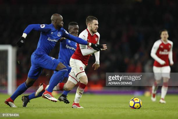 Arsenal's Welsh midfielder Aaron Ramsey vies with Everton's French defender Eliaquim Mangala during the English Premier League football match between...