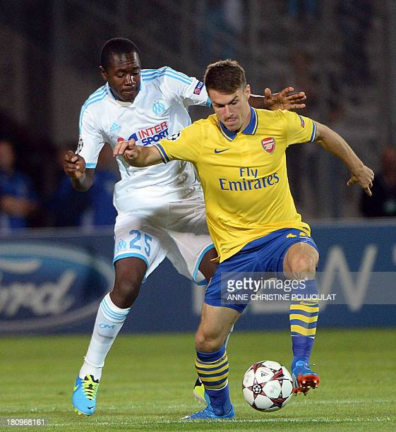 Arsenal's Welsh midfielder Aaron Ramsey vies with Marseille's French midfielder Giannelli Imbula during the UEFA Champions League group F football...