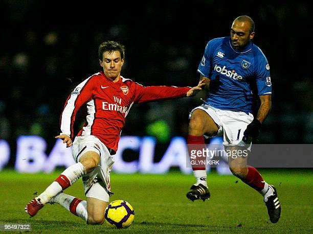 Arsenal's Welsh midfielder Aaron Ramsey vies with Portsmouth's Zairian midfielder Anthony Vanden Borre during their English Premier League football...