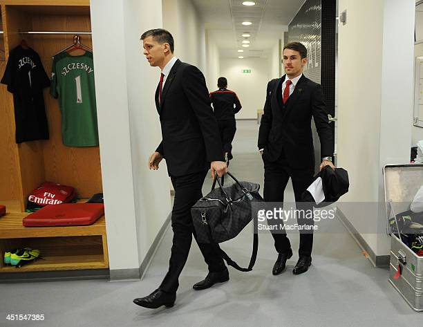 Arsenal's Wojciech Szczesny and Aaron Ramsey arrive in the changing room before the match at Emirates Stadium on November 23 2013 in London England