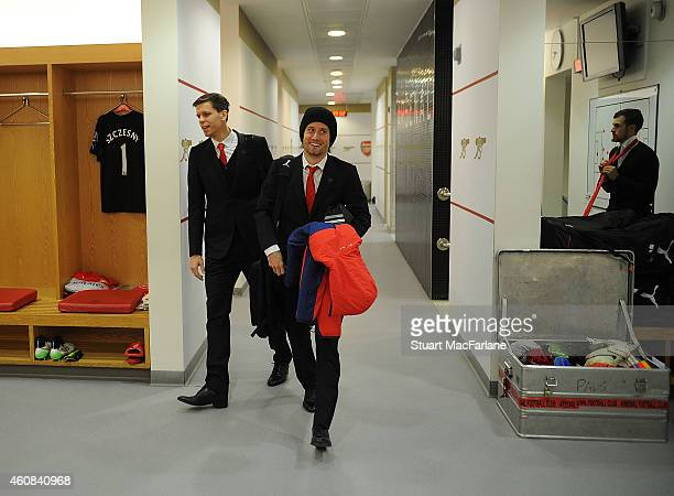 Arsenal's Wojciech Szczesny and Tomas Rosicky in the home changing room before the Barclays Premier League match between Arsenal and Queens Park...