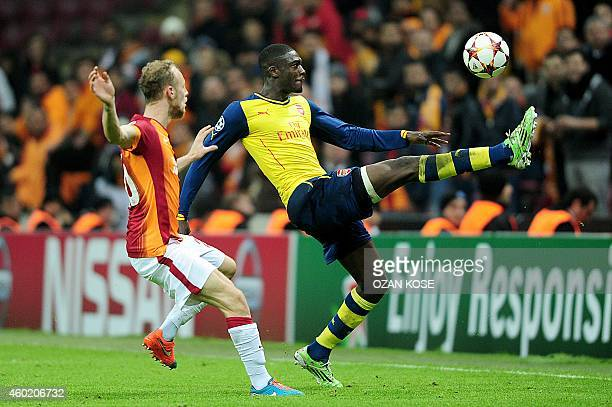 Arsenal's Yaya Sanogo vies for the ball with Galatasaray's Semih Kaya during the UEFA Champions League group D football match Galatasaray vs Arsenal...