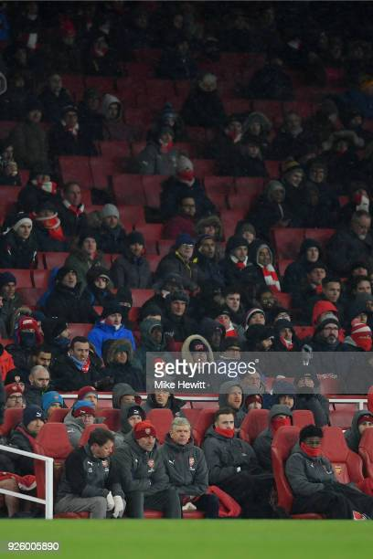 Arsene Wenger Arsenal manager looks on from the bench during the Premier League match between Arsenal and Manchester City at Emirates Stadium on...