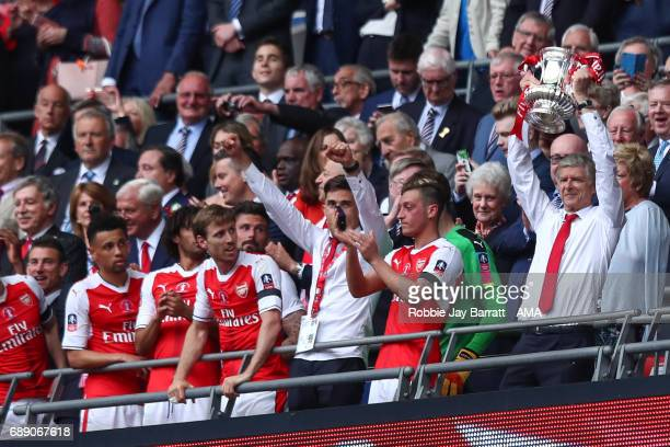 Arsene Wenger head coach / manager lifts The Emirates FA Cup trophy during the Emirates FA Cup Final match between Arsenal and Chelsea at Wembley...