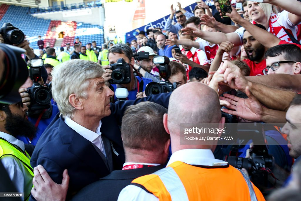 Arsene Wenger head coach / manager of Arsenal engages with the fans of Arsenal at full time after he comes back out during the Premier League match between Huddersfield Town and Arsenal at John Smith's Stadium on May 13, 2018 in Huddersfield, England.