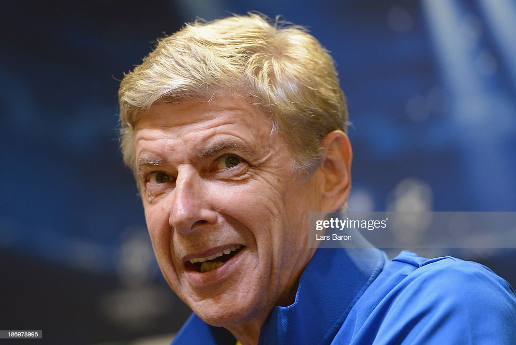 Arsene Wenger looks on during a Arsenal press conference ahead of the UEFA Champions League Group F match against Borussia Dortmund at Signal Iduna Park on November 5, 2013 in Dortmund, Germany.