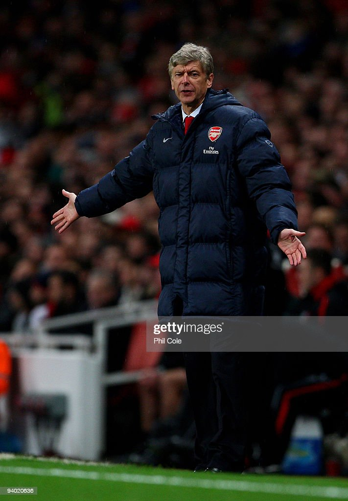 Arsene Wenger managar of Arsenal shouts instructions to his players during the Barclays Premier League match between Arsenal and Stoke City at the Emirates Stadium on December 5, 2009 in London, England.