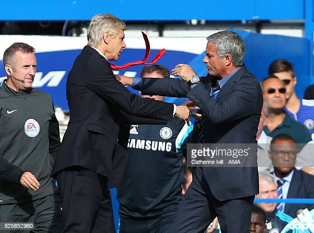 Arsene Wenger manager / head coach of Arsenal goes over to Jose Mourinho the head coach / manager of Chelsea and pushes him resulting in a scuffle...