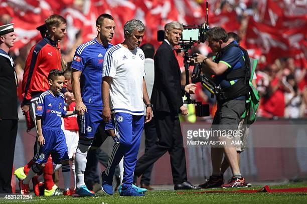 Arsene Wenger manager / head coach of Arsenal looks over his shoulder as Jose Mourinho the head coach / manager of Chelsea walks out with his team...