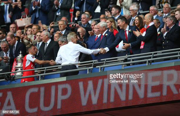 Arsene Wenger manager / head coach of Arsenal shakes hands with director Josh Kroenke the Emirates FA Cup Final match between Arsenal and Chelsea at...