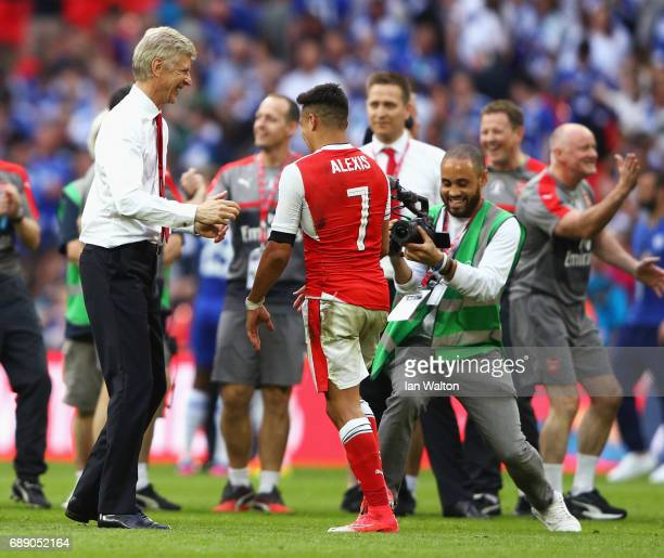 Arsene Wenger Manager of Arsenal and Alexis Sanchez of Arsenal celebrate after The Emirates FA Cup Final between Arsenal and Chelsea at Wembley...