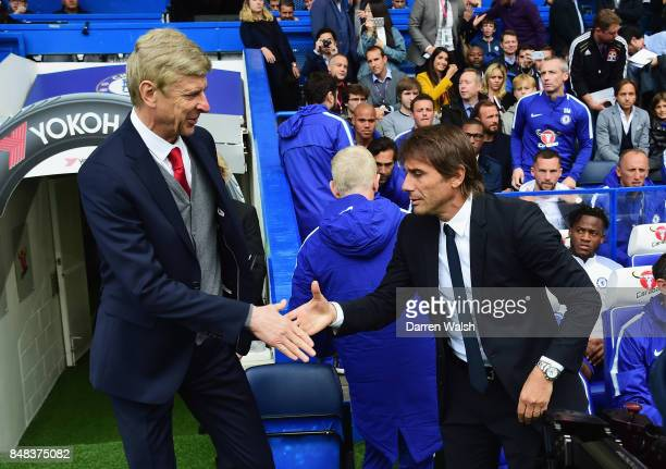 Arsene Wenger Manager of Arsenal and Antonio Conte Manager of Chelsea shake hands prior to the Premier League match between Chelsea and Arsenal at...