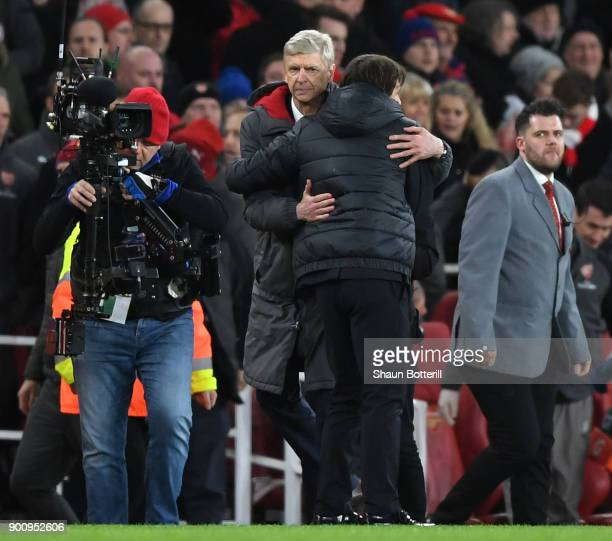 Arsene Wenger Manager of Arsenal and Antonio Conte Manager of Chelsea embrace after the final whistle after the Premier League match between Arsenal...