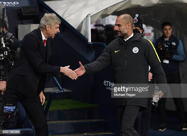 Arsene Wenger Manager of Arsenal and Josep Guardiola Manager of Manchester City shake hands prior to kick off during the Premier League match between...