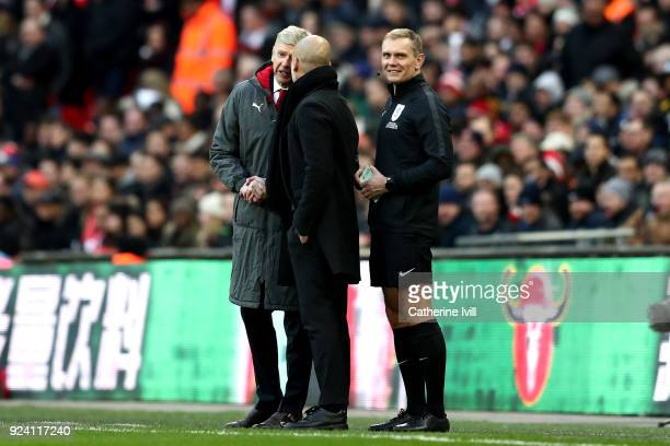 Arsene Wenger Manager of Arsenal and Josep Guardiola Manager of Manchester City argue during the Carabao Cup Final between Arsenal and Manchester...